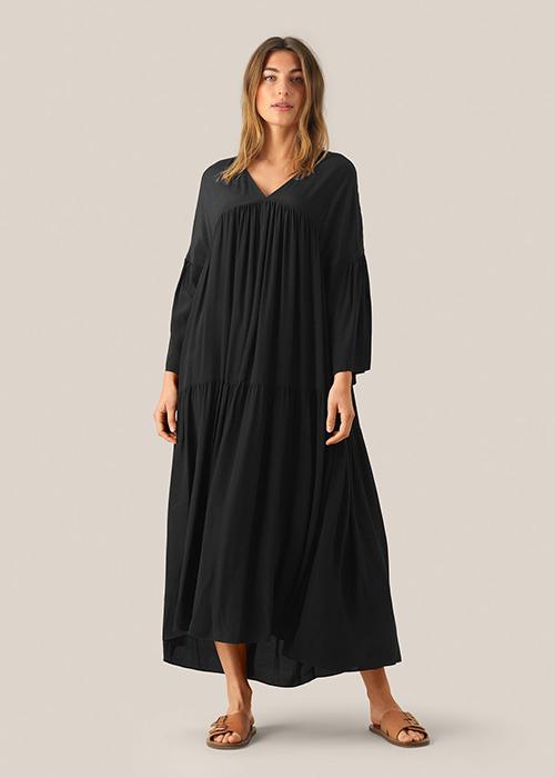 SECOND FEMALE BLACK DRESS